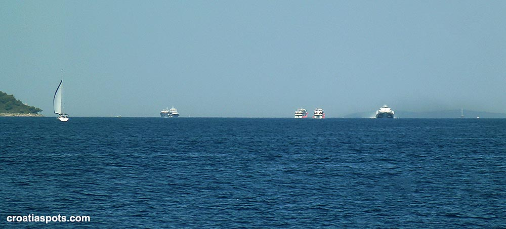 Fast foot passenger ferry on horizon