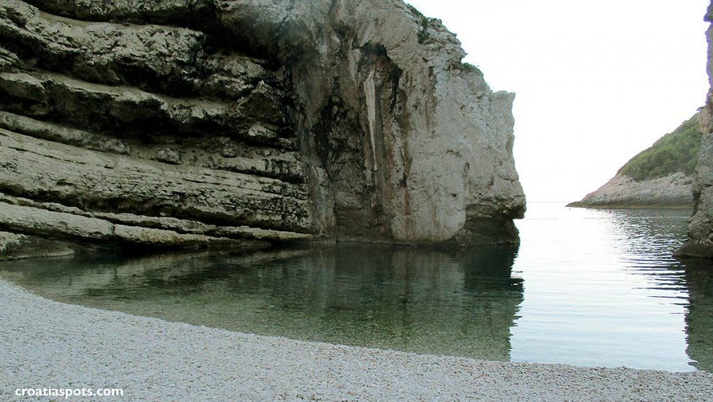 Beach, calm water and rock formations