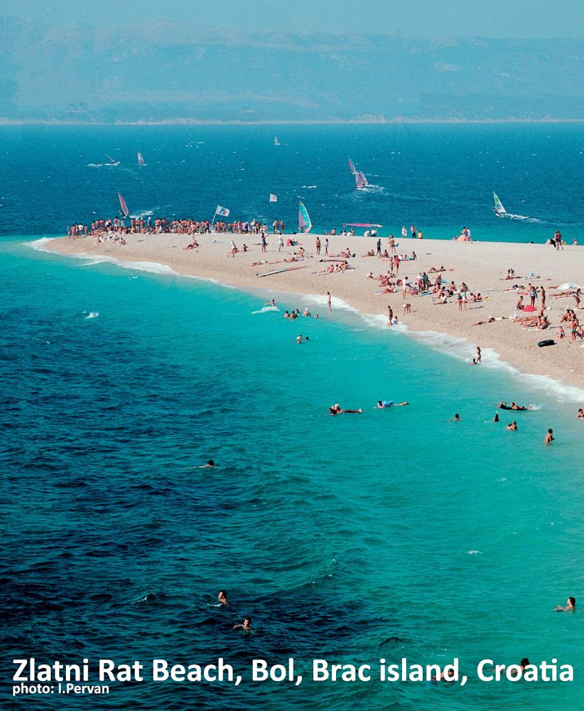 The horn of Zlatni Rat on the busy summers day with windsurfers and sunbathers